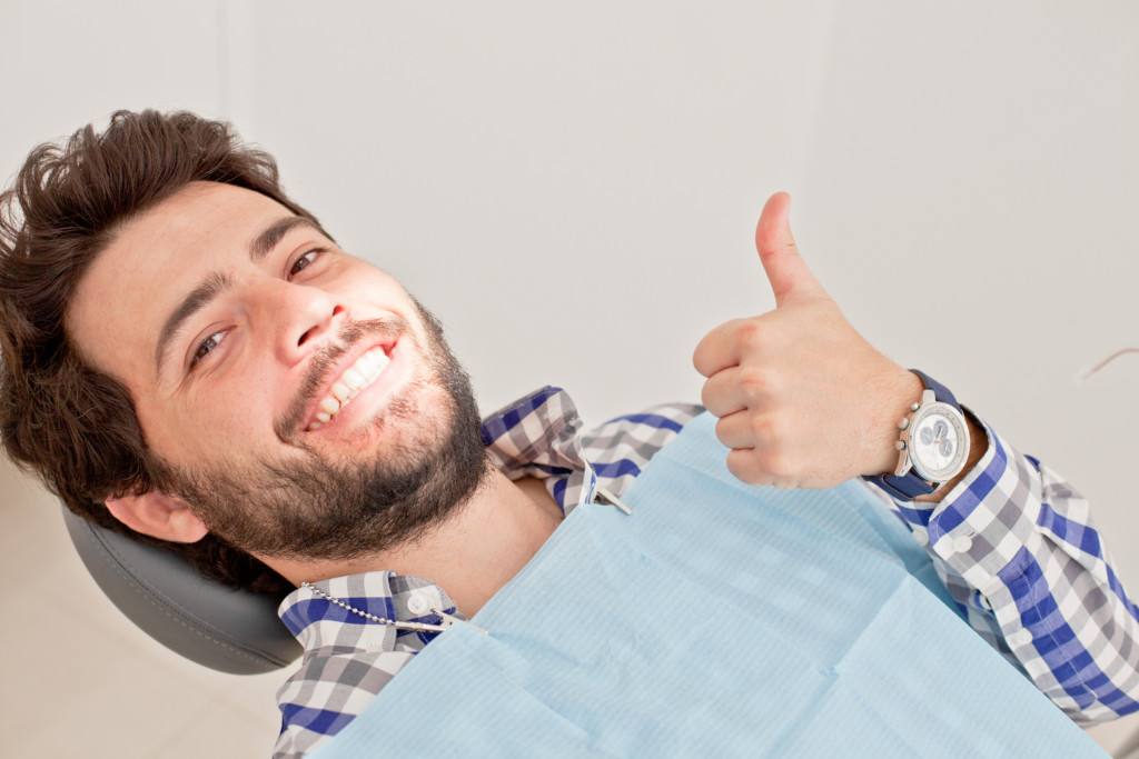 man in a dental examination at dentist getting patient care