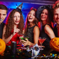 girls smiling and laughing at a halloween party