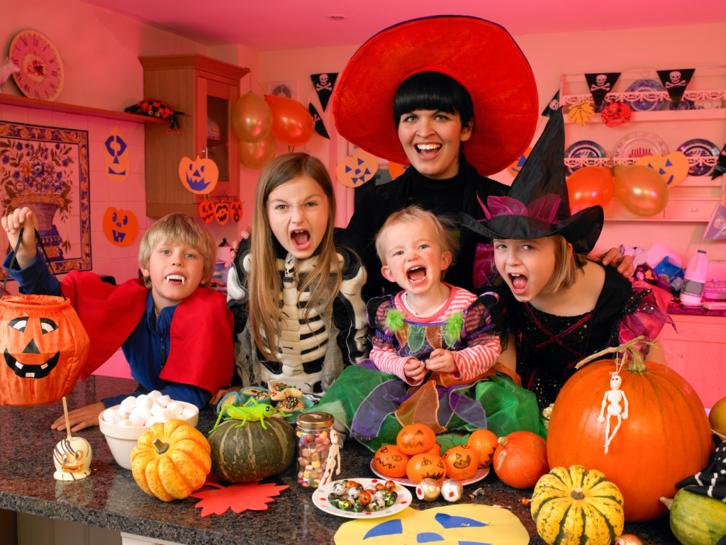 "Children in Family Screaming ""Happy Halloween"""