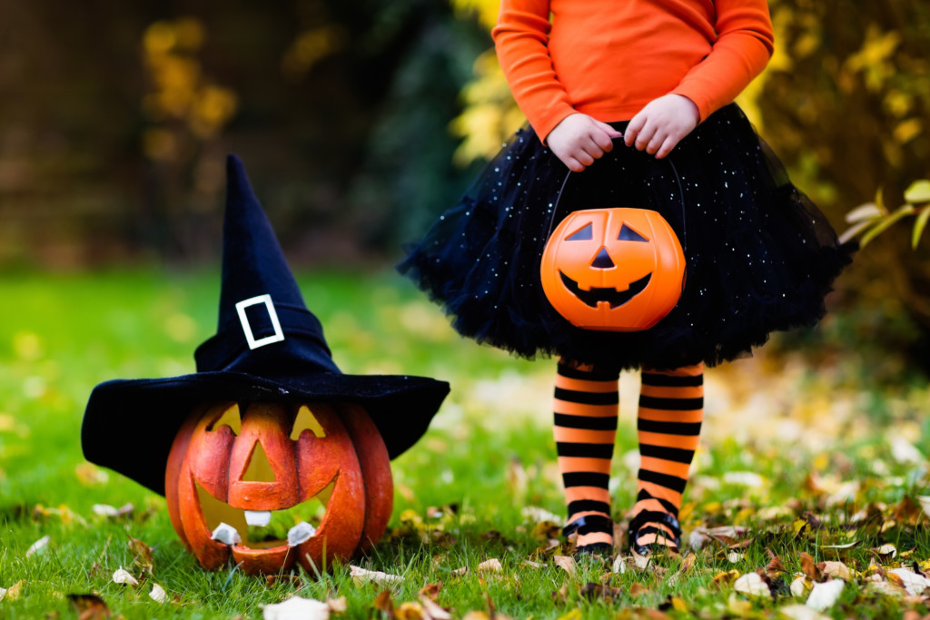 Young Girl in Stockings with a Jack-O-Lantern