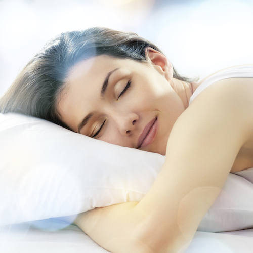 A sleeping woman shows how sedation dentistry can take the anxiety out of your next dental visit.