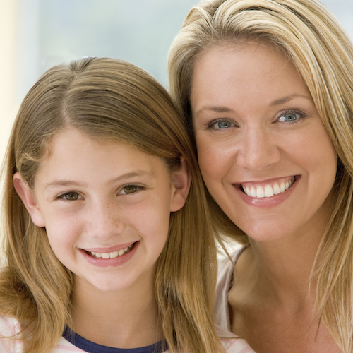 A mother and daughter smile to illustrate the importance of preventive dental care with our dentist in the Elkton area.