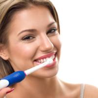Young beautiful woman brushing her healthy teeth