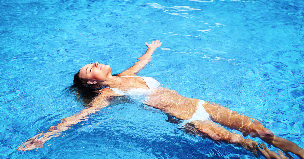 A woman relaxing in the pool